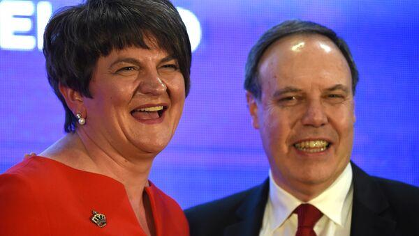 DUP leader Arlene Foster and deputy leader Nigel Dodds are seen after Arlene Fosters speech at her party's annual conference in Belfast, Northern Ireland, November 25, 2017. - Sputnik International