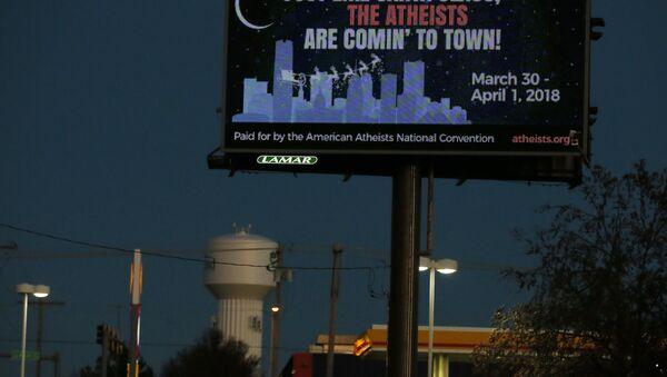 A billboard is pictured in Edmond, Okla, Wednesday, Dec. 6, 2017. - Sputnik International