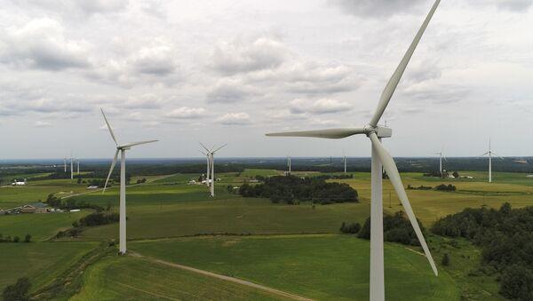 Wind turbines slowly spin in the wind at the High Sheldon Wind Farm,10 July 2017, in Sheldon, N.Y.  - Sputnik International
