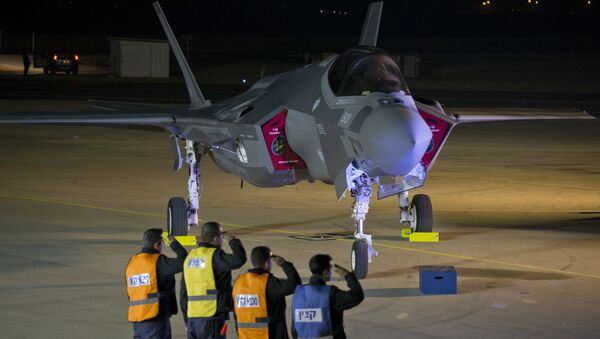 Israeli air force officers salute toward one of the first two next-generation F-35 fighter jets during an unveiling ceremony after it landed in Nevatim Air Force base near Beersheba, Southern Israel, Monday, Dec. 12, 2016 - Sputnik International
