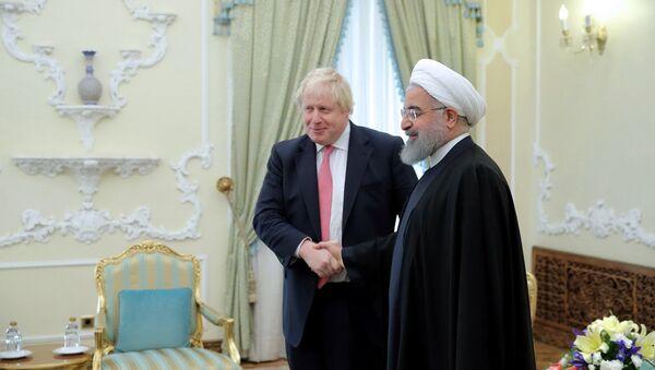 Britain's Foreign Secretary Boris Johnson meets with Iranian President Hassan Rouhani, in Tehran, Iran December 10, 2017 - Sputnik International