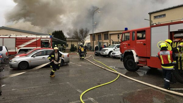 Emergency crews are seen attending to a fire after reports of a gas explosion in Baumgarten, Austria December 12, 2017 in this picture obtained from social media - Sputnik International