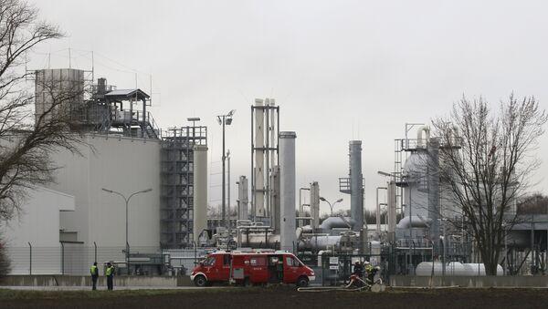 Firefighters stand outside a gas plant after an explosion occured near Baumgarten an der March, Austria, Tuesday, Dec. 12, 2017 - Sputnik International