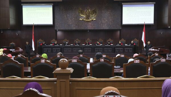 Judges read their verdict on the case of a petition seeking to make gay sex and sex outside marriage illegal during a hearing at the Constitutional Court in Jakarta, Indonesia - Sputnik International
