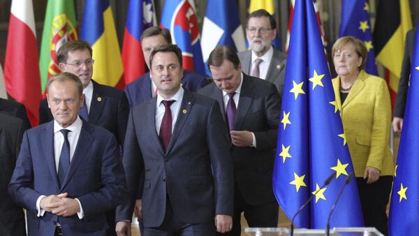 European Council President Donald Tusk, front center, and European Commission President Jean-Claude Juncker, front left, lead EU leaders to a group photo at an EU summit at the Europa building in Brussels on Thursday, Dec. 14, 2017 - Sputnik International