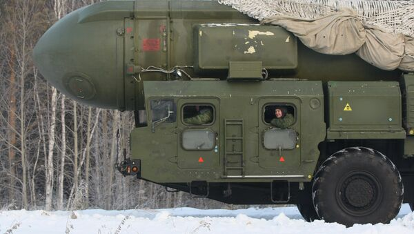 The RT-2PM Topol ballistic missile riding to the site of its permanent deployment with the Strategic Missile Forces of the Central Military District - Sputnik International