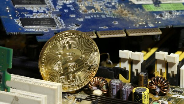 A copy of bitcoin standing on PC motherboard is seen in this illustration picture, October 26, 2017 - Sputnik International