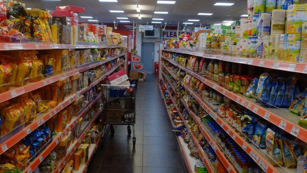 A typical aisle in Maxi Poli, Polish goods superstore, Thetford, UK - Sputnik International