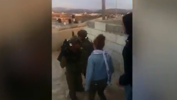 Ahed Tamimi gets arrested by IDF forces after slapping soldiers - Sputnik International