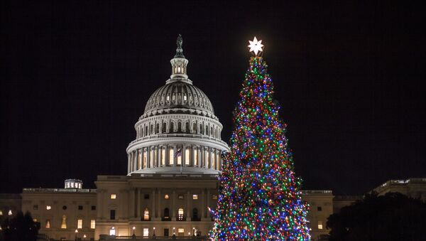 The Capitol Christmas tree is illuminated as lawmakers in the Senate work late into the evening on the Republican tax bill, in Washington, Tuesday, Dec. 19, 2017 - Sputnik International