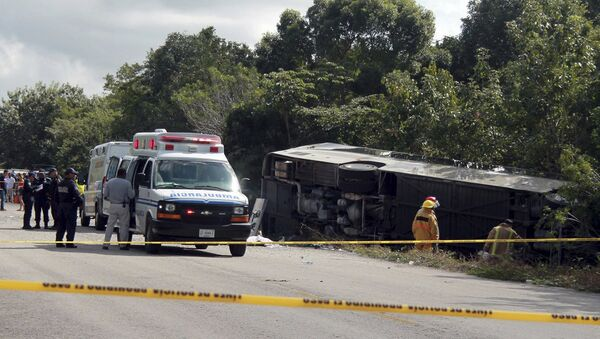 An ambulance sits parked next to an overturned bus in Mahahual, Quintana Roo state, Mexico - Sputnik International