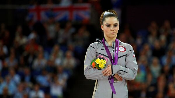 McKayla Maroney of the U.S. celebrates with her silver medal in the women's vault victory ceremony in the North Greenwich Arena during the London 2012 Olympic Games August 5, 2012 - Sputnik International