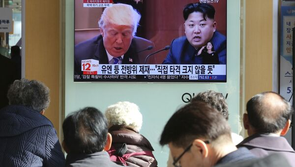 FILE- In this Tuesday, Nov. 21, 2017, file photo, people watch a TV screen showing images of U.S. President Donald Trump, left, and North Korean leader Kim Jong Un at Seoul Railway Station in Seoul, South Korea - Sputnik International