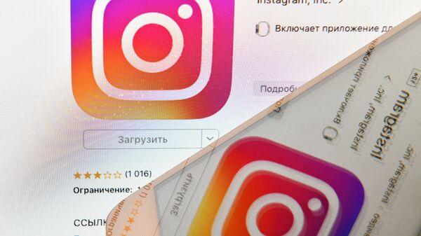 Icon of Instagram social media as seen on a smartphone screen - Sputnik International