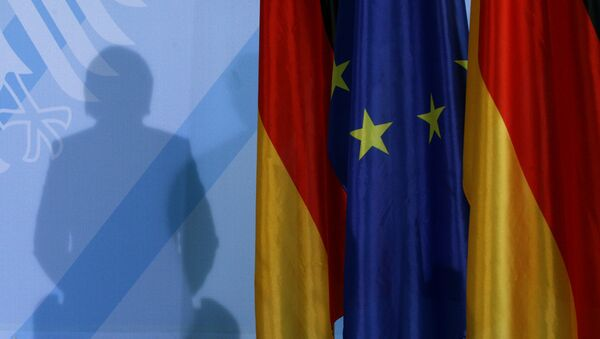 The shadow of German Chancellor Angela Merkel photographed as she addresses the media after a meeting with German parliament floor leaders about the European Union bail-out in Berlin, Monday, May 10, 2010. - Sputnik International