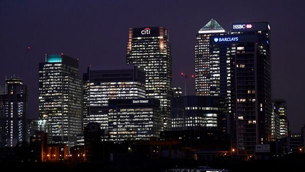 Office blocks of Citi, Barclays, and HSBC banks are seen at dusk in the Canary Wharf financial district in London, Britain November 16, 2017 - Sputnik International