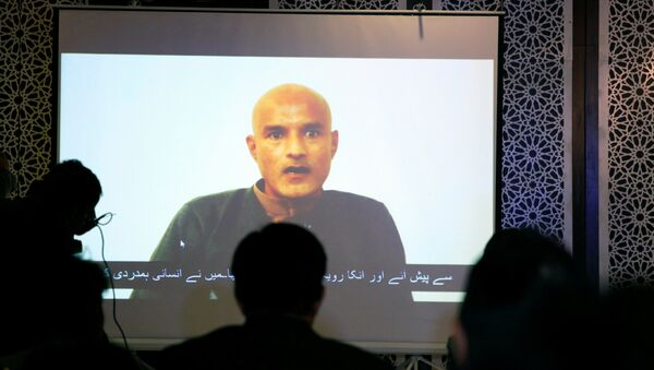 Former Indian navy officer Kulbhushan Sudhir Jadhav is seen on a screen during a news conference at the Ministry of Foreign Affairs in Islamabad, Pakistan December 25, 2017 - Sputnik International