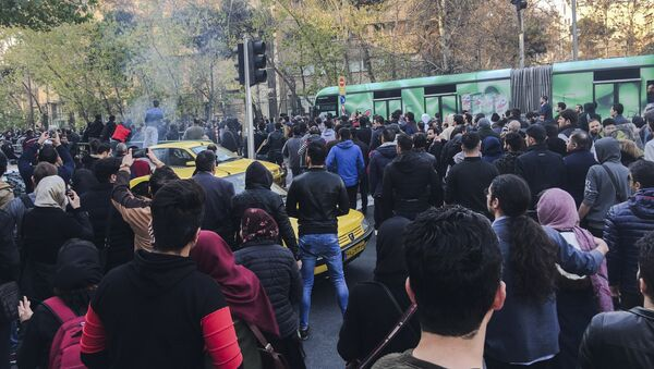 This photo taken by an individual not employed by the Associated Press and obtained by the AP outside Iran, demonstrators attend a protest over Iran's weak economy, in Tehran, Iran, Saturday, Dec. 30, 2017 - Sputnik International