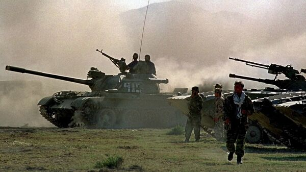 Northern alliance armor warm up their engines, during preparations for an offensive against Afghanistan's Taliban movement in Takhar province, some 15 km (9 miles) from the Tajik-Afghan border in Afghanistan, Thursday, Oct. 4, 2001. The opposition alliance in northern Afghanistan is coordinating its offensive with the United States, an opposition spokesman said Wednesday, and it is expecting fresh arms deliveries from two of its strongest allies in the fight against the Taliban: Iran and Russia. - Sputnik International