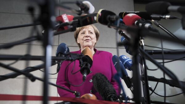German chancellor Angela Merkel delivers a statement in Berlin, Sunday, Jan. 7, 2018. German Chancellor Angela Merkel embarked Sunday on talks with the center-left Social Democrats on forming a new government, with leaders stressing the need for speed as they attempt to break an impasse more than three months after the country's election. - Sputnik International