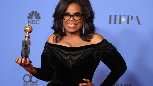 75th Golden Globe Awards – Photo Room – Beverly Hills, California, U.S., 07/01/2018 – Oprah Winfrey poses backstage with her Cecil B. DeMille Award - Sputnik International