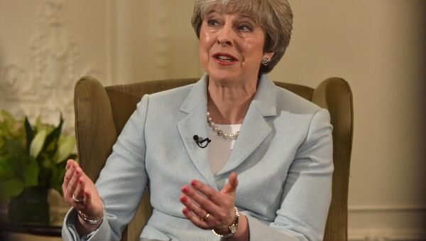 Britain's Prime Minister Theresa May speaks on the BBC's Andrew Marr Show, in this photograph received via the BBC, in her Maidenhead constituency in Britain January 6, 2018 - Sputnik International