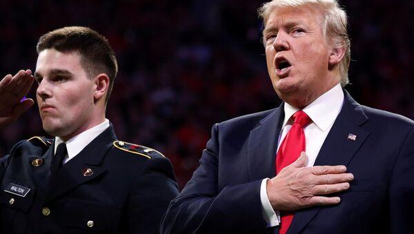U.S. President Donald Trump sings along with the national anthem before the NCAA College Football Playoff Championship game between Alabama and Georgia in Atlanta, Georgia, U.S. January 8, 2018 - Sputnik International