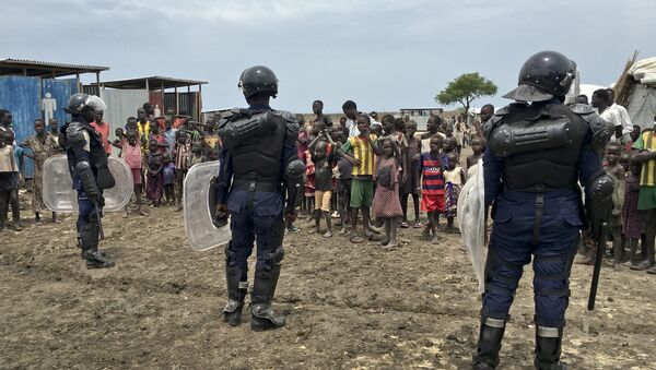 A crowd of displaced people look on as members of the U.N. multi-national police contingent provide security during a visit of UNCHR High Commissioner Filippo Grandi to South Sudan's largest camp for the internally-displaced, in Bentiu, South Sudan Sunday, June 18, 2017 - Sputnik International
