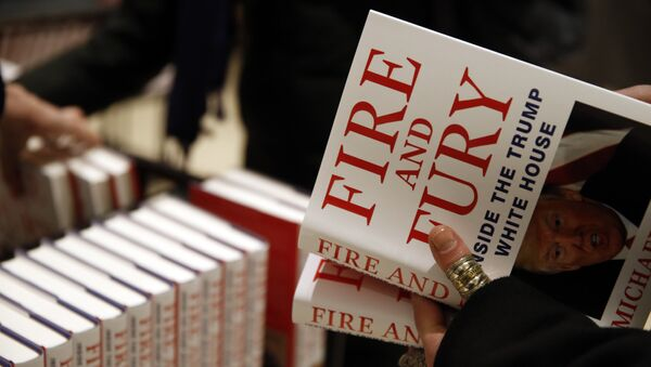 A customer looks at a copy of Michael Wolff's Fire and Fury: Inside the Trump White House as they go on sale at a bookshop, in London, Tuesday, Jan. 9, 2018. - Sputnik International