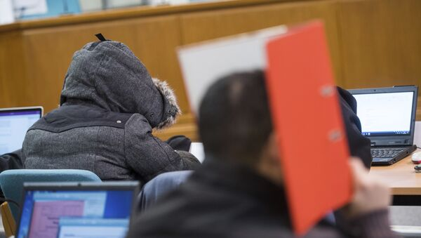 """(File) In this Nov. 9, 2016 file photo defendants wait for the start of the hearing in the district court in Wuppertal, Germany. A German federal court on Thursday Jan. 11, 2018 overturned the acquittal of seven men who posed as a self-styled """"Sharia police,"""" ordering a retrial on charges that they violated rules on wearing uniforms. - Sputnik International"""