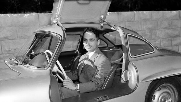 King Hussein of Jordan sits in his new Mercedes-Benz sports car at the Jordanian Royal Palace in Amman, Jordan, Oct. 30, 1957. The car is one of the latest models with gull-wing doors. - Sputnik International