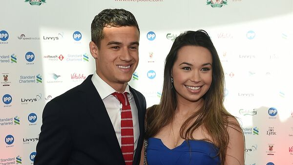 (File) Liverpool's Brazilian midfielder Philippe Coutinho an his wife Aine arrive to attend the Liverpool Football Club 2015 Players' Awards at the Echo Arena in Liverpool on May 19, 2015 - Sputnik International