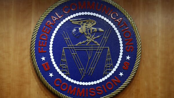 The seal of the Federal Communications Commission (FCC) is seen before an FCC meeting to vote on net neutrality in Washington. (File) - Sputnik International