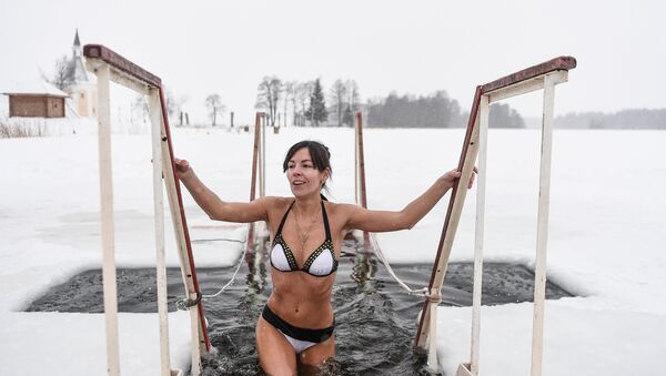 A young woman during the traditional bathing on Orthodox Epiphany Eve (File) - Sputnik International