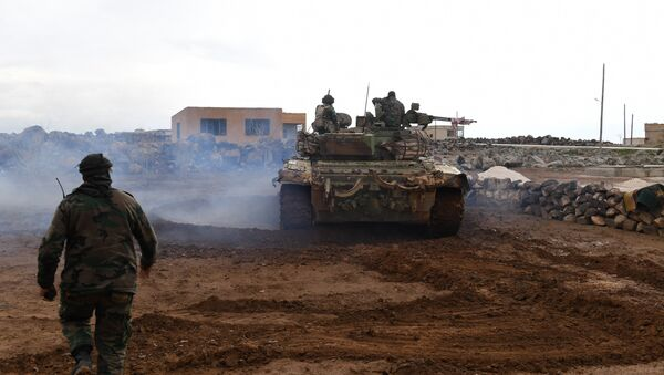 Syrian government forces gather in the village of Obeid, in the southern part of Aleppo province on January 18, 2018, as they advance towards the Abu Duhur military airport in the ongoing offensive against opposition fighters - Sputnik International