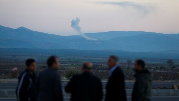 Smoke rises from the Syria's Afrin region, as it is pictured from near the Turkish town of Hassa, on the Turkish-Syrian border in Hatay province, Turkey January 20, 2018 - Sputnik International