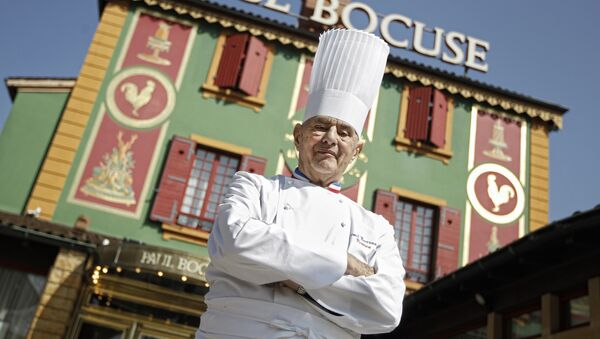In this March 24, 2011 file French Chef Paul Bocuse poses outside his famed Michelin three-star restaurant L'Auberge du Pont de Collonges in Collonges-au-Mont-d'or, central France - Sputnik International