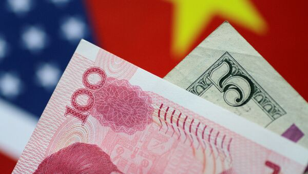 U.S. Dollar and China Yuan notes are seen in this picture illustration June 2, 2017 - Sputnik International
