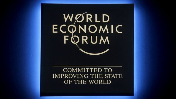 A Forum's logo shines during the annual meeting of the World Economic Forum in Davos, Switzerland, Tuesday, Jan. 23, 2018 - Sputnik International
