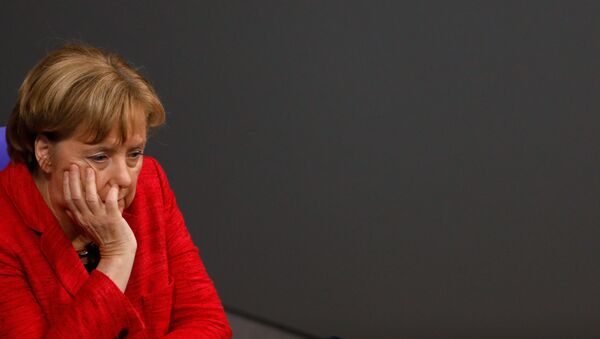 German Chancellor Angela Merkel looks on during a session at the Bundestag lower house of Parliament, on November 21, 2017 in Berlin. - Sputnik International