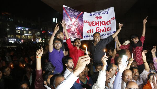 Members of India's Rajput community holds a banner and candles and shouts slogans during a protest against the release of Bollywood film Padmaavat in Ahmadabad, India - Sputnik International