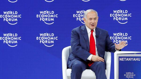 Israel's Prime Minister Benjamin Netanyahu gestures as he speaks the World Economic Forum (WEF) annual meeting in Davos, Switzerland - Sputnik International