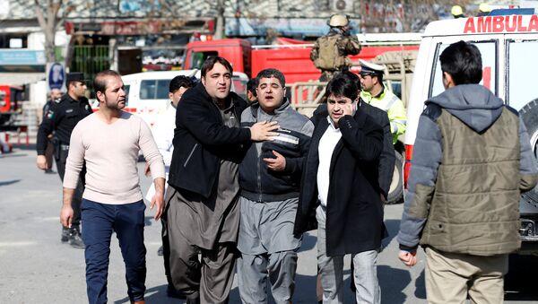 People assist an injured man after a blast in Kabul, Afghanistan January 27, 2018 - Sputnik International
