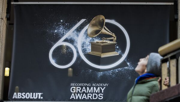 A young boy walks past advertisements promoting the 60th Annual Grammy Awards at the Madison Square Garden in New York on January 26, 2018 - Sputnik International