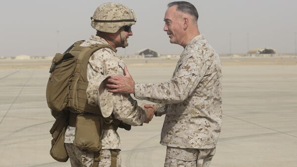 Brig. Gen. Roger Turner, left, commanding general of Task Force Southwest, greets Gen. Joseph F. Dunford Jr., chairman of the Joint Chiefs of Staff, at Bastion Airfield, Afghanistan, June 28, 2017 to reaffirm Department of Defense commitment to train, advise and assist Afghan missions - Sputnik International