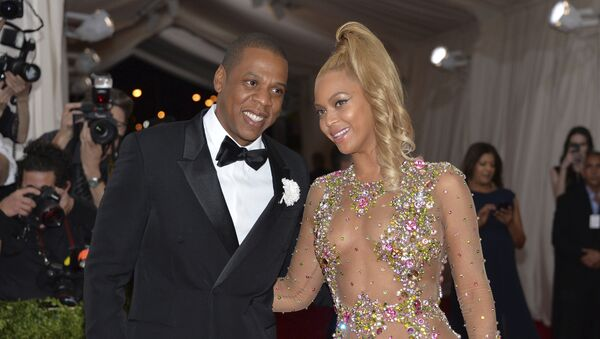In this May 4, 2015, file photo, Jay Z, left, and Beyonce arrive at The Metropolitan Museum of Art's Costume Institute benefit gala celebrating China: Through the Looking Glass in New York - Sputnik International