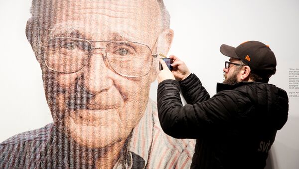 A visitor to the IKEA museum takes a mobile photo of a picture of Ingvar Kamprad, founder of Swedish multinational furniture retailer IKEA, in Almhult, Sweden, January 28, 2018 - Sputnik International