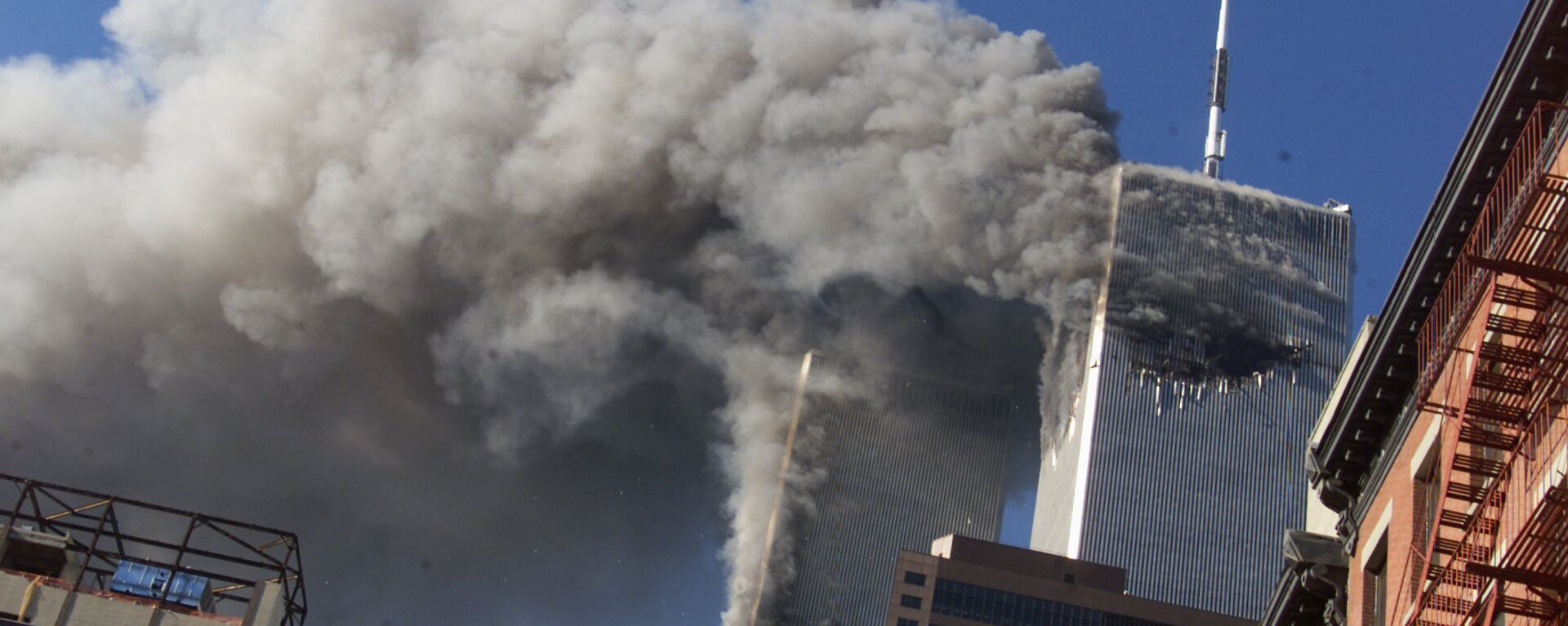 This 11 September 2001 file photo shows smoke rising from the burning twin towers of the World Trade Center after hijacked planes crashed into the towers, in New York City. - Sputnik International, 1920, 26.08.2021