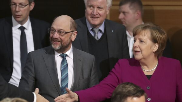 Martin Schulz, chairman of the German Social Democratic Party (SPD), front left, German Chancellor and chairwomen of the German Christian Democratic Union (CDU), Angela Merkel, front right, and Horst Seehofer, rear center, chairman of the Christian Social Union (CSU), arrive for coalition negotiations on a new German government between the Christian Unions bloc and the Social Democratic Party (SPD) in Berlin, Germany, Friday, Feb. 2, 2018. - Sputnik International