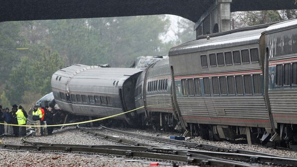Emergency responders are at the scene after an Amtrak passenger train collided with a freight train and derailed in Cayce, South Carolina, U.S., February 4, 2018. - Sputnik International